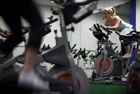 Instructor Kirsten Durocher orchestrated a workout recently for spin enthusiasts at Velo-City in Boston's Back Bay.